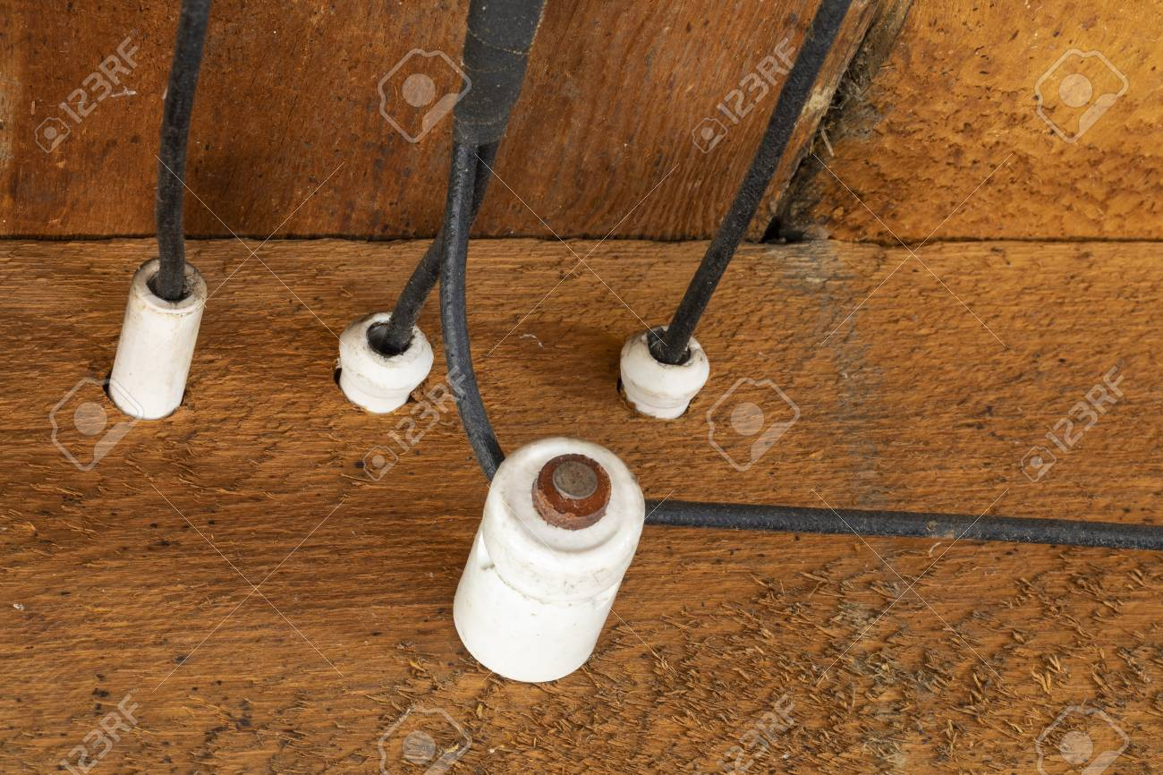 Old Outdated Electrical Wiring in the ceiling of an old house. on