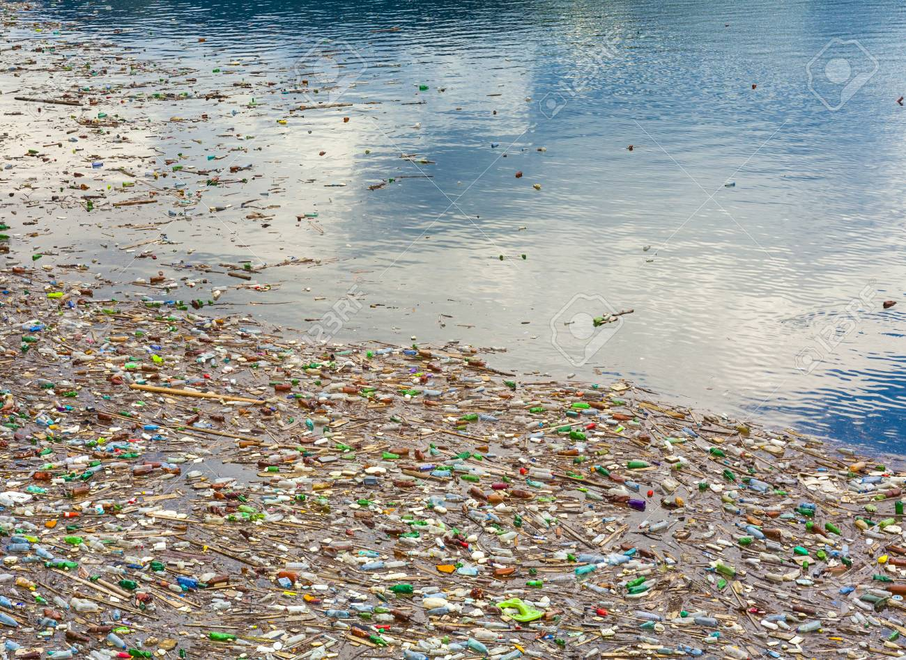 lake pollution with plastic bags and toxic waste in the water - 105401967