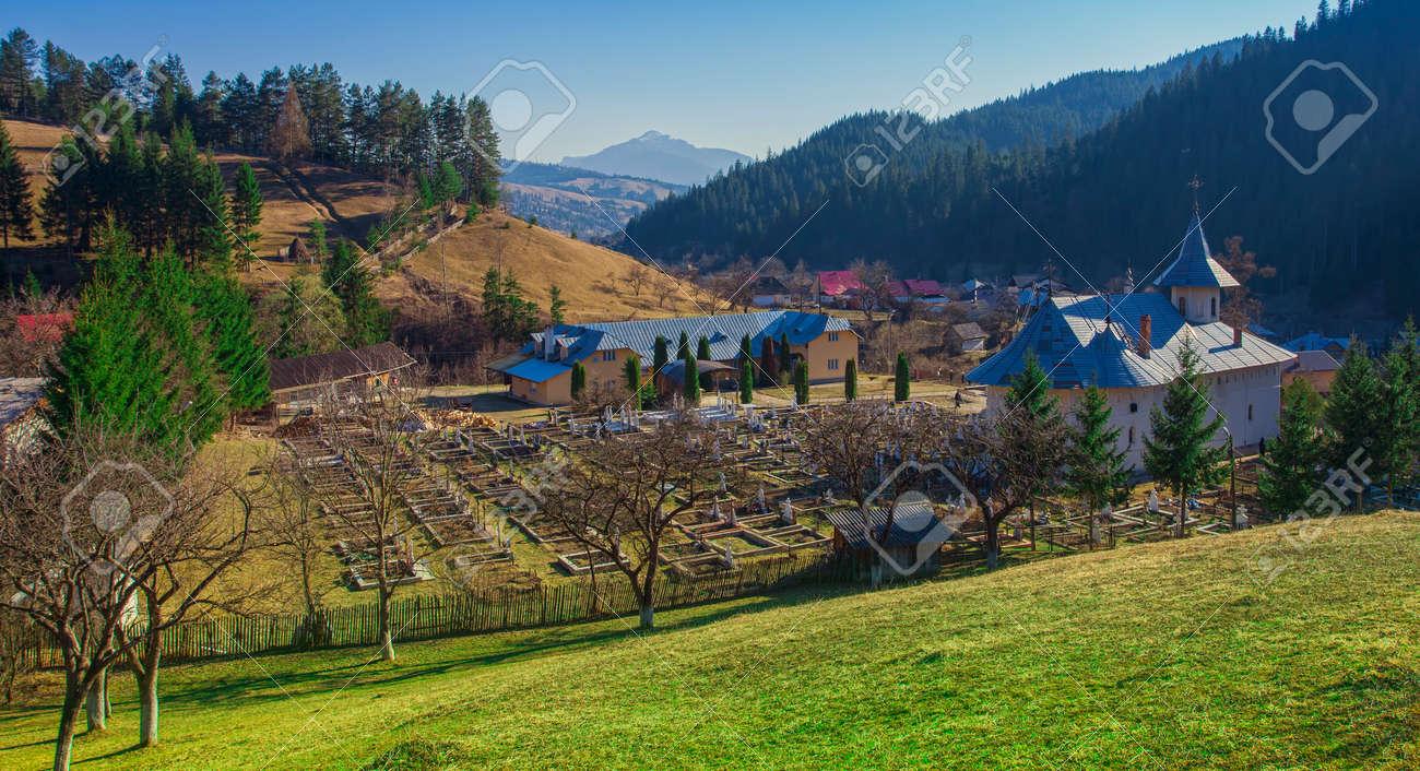 church and mountain landscape in Petru Voda, Romania - 120371143