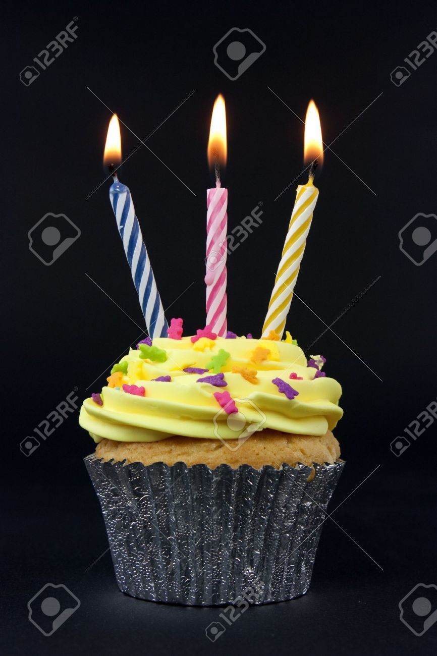 cupcake on black with 3 candles on black Stock Photo - 5860103