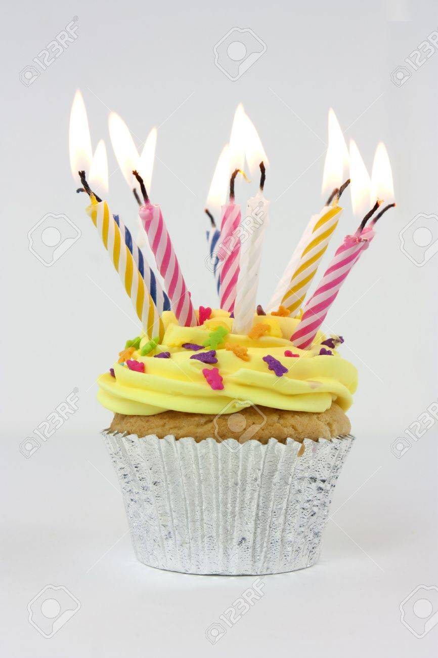 Photo Of A Cupcake Or Birthday Cake With Lots Of Candles Stock Photo