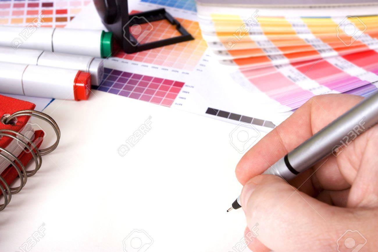 designer surrounded by design colour swatches and pens with blank paper Stock Photo - 8595693