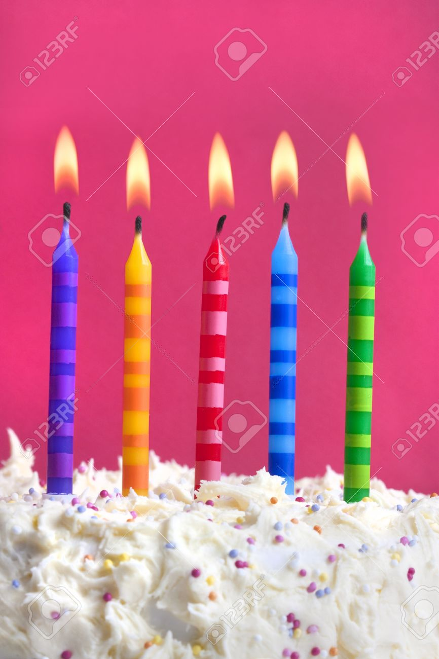 Close Up Macro Photograph Of 5 Candles On A Birthday Cake Stock