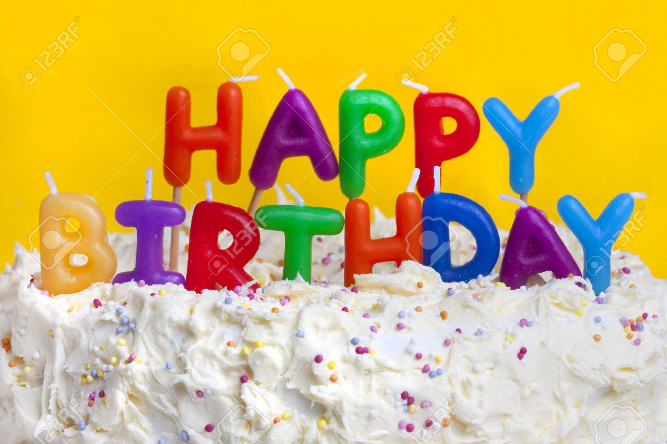 Astounding Happy Birthday Cake Shot On A Yellow Background With Candles Stock Funny Birthday Cards Online Fluifree Goldxyz