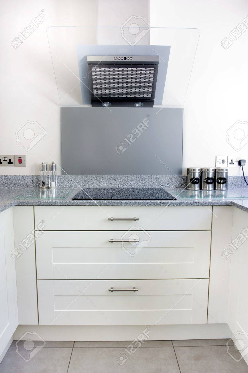 modern white kitchen extractor fan and hob