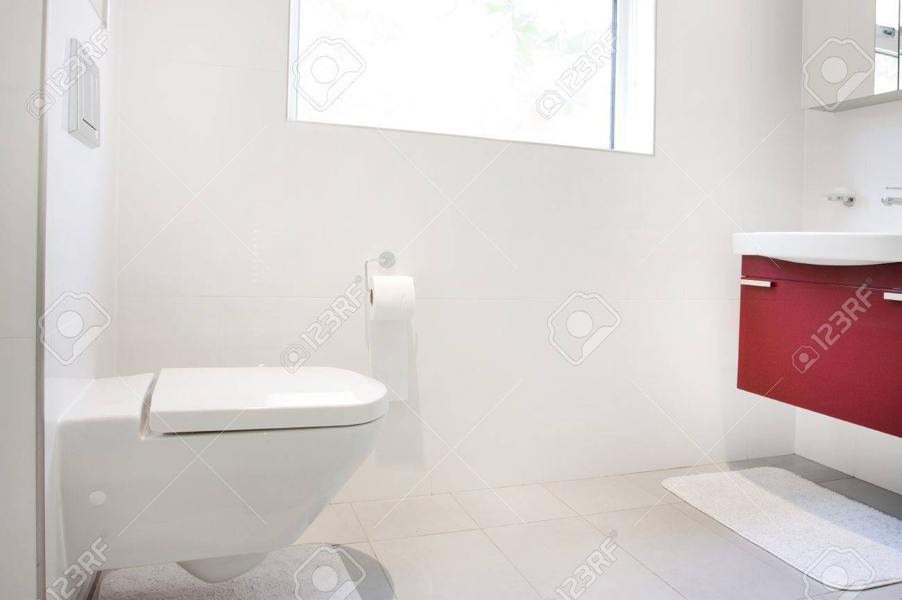 Modern Bathroom With Wall Hung Toilet And Sink Unit Stock Photo