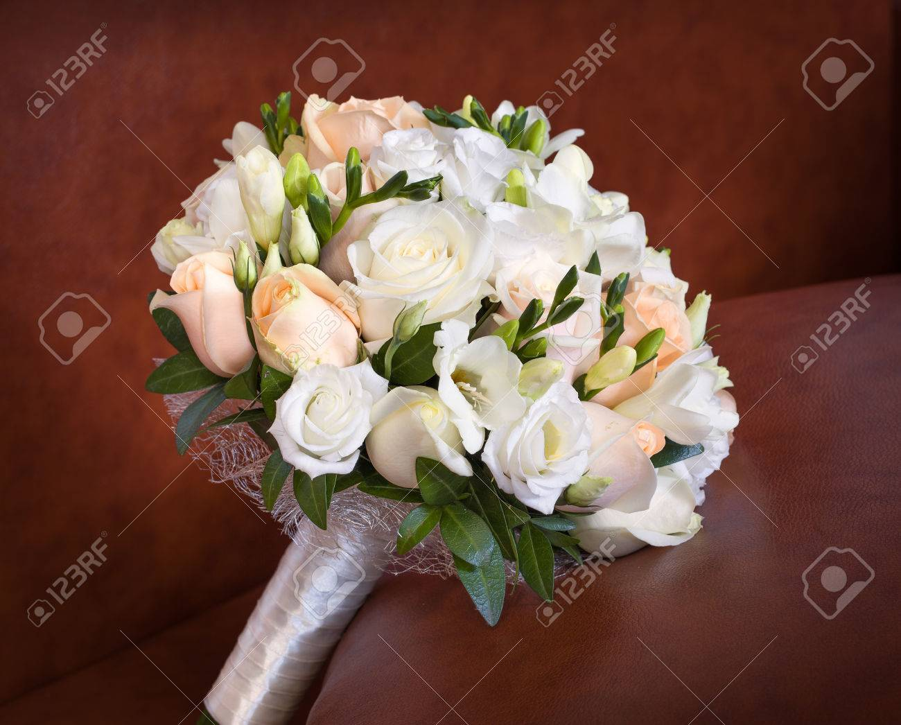 Bright Roses Wedding Bouquet On The Brown Leather Sofa. Stock Photo ...