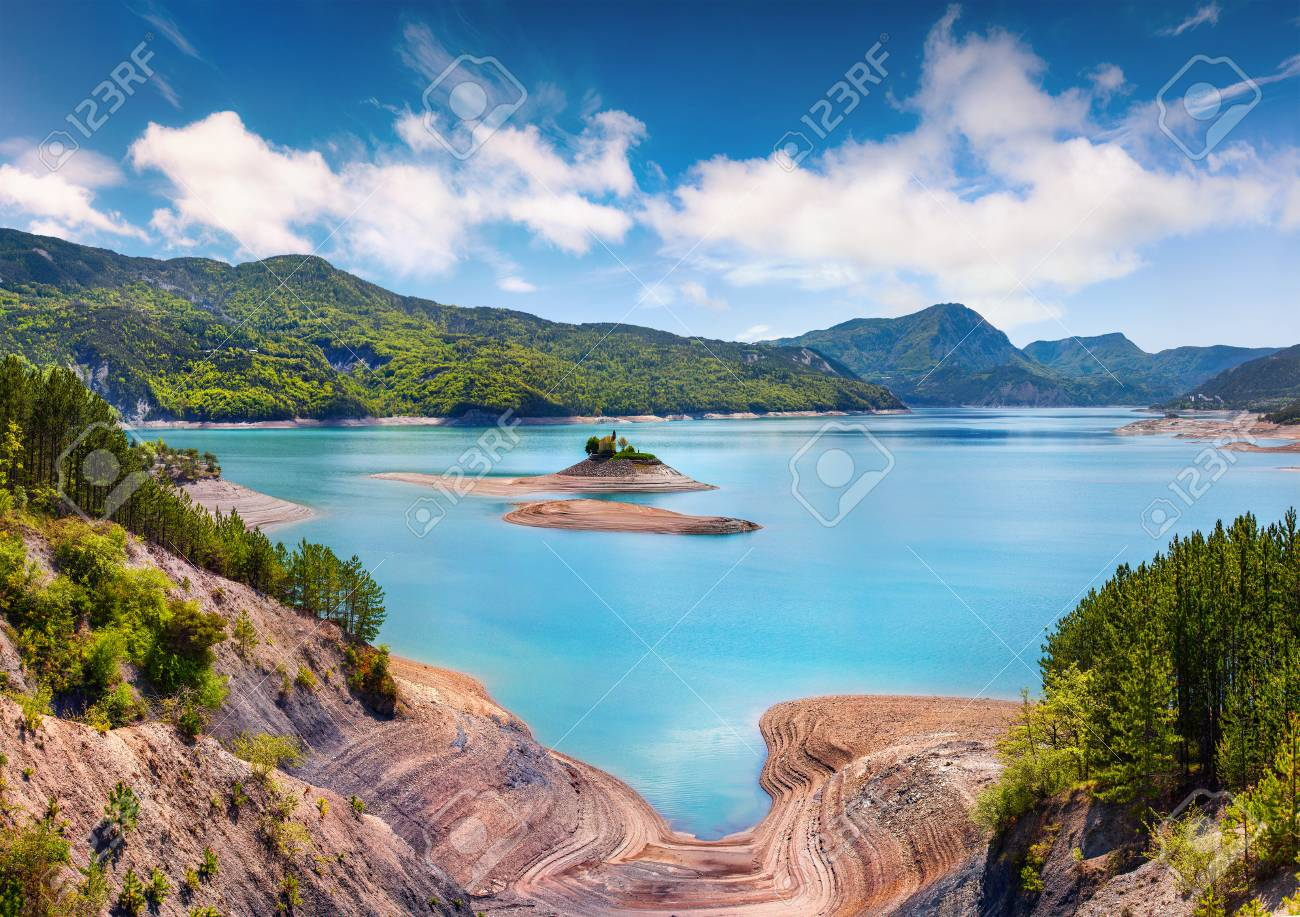 Colorful summer landscape on the Serre-Poncon lake. Sunny morning view of the French Alps, Les Bernards village location, Hautes-Alpes department, southeastern France, Europe. - 89423682