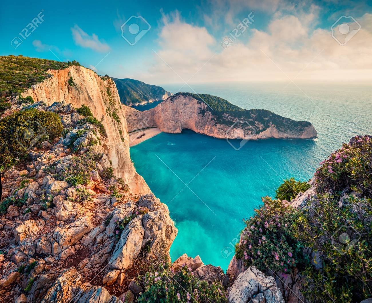 Colorful spring view of Navagio beach with shipwreck. Sunny morning seascape of Ionian Sea, Zakynthos (Zante) island, Greece, Europe. - 96466317