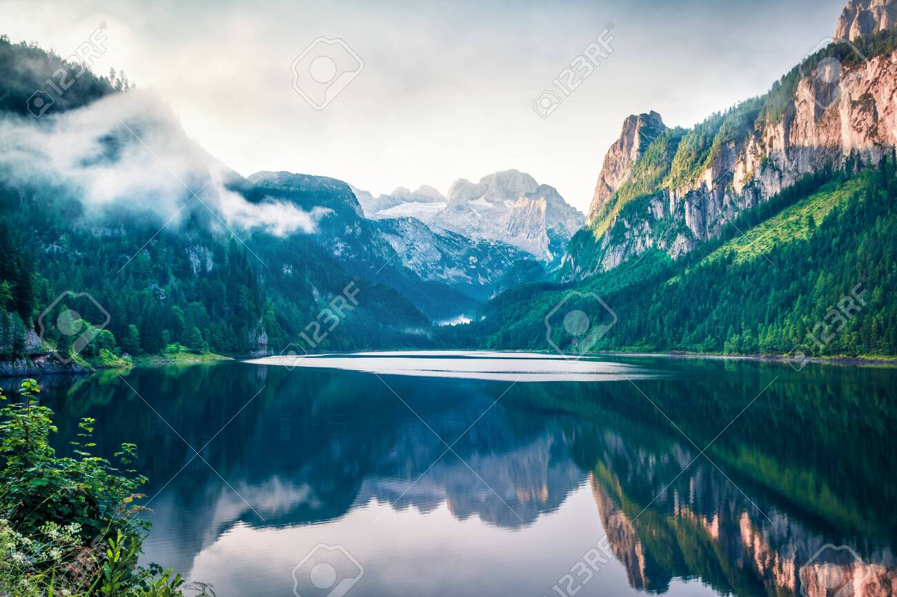 Colorful summer scene of Vorderer ( Gosausee ) lake with Dachstein glacier on background. Amazing morning view of Austrian Alps, Upper Austria, Europe. Orton Effect. - 131849234
