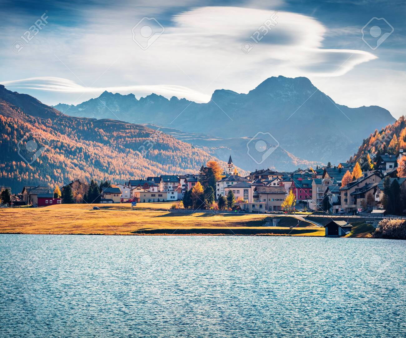 Stunning autumn cityscape of Silvaplana town. Splendid morning view of Lake Champfer, Upper Engadine in the Swiss canton of the Grisons, Switzerland, Europe. Traveling concept background. - 140764661