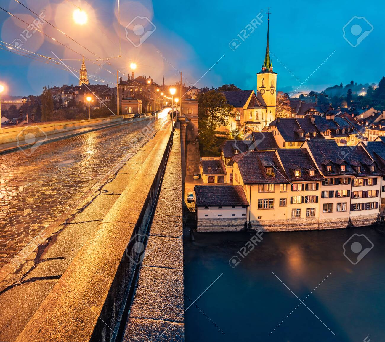 Rainy evening view of Nydeggkirche - Protestant church. Bern town with Cathedral of Bern on background. Gorgeous autumn sunrise in Switzerland, Aare River, Europe. Traveling concept background. - 148650882