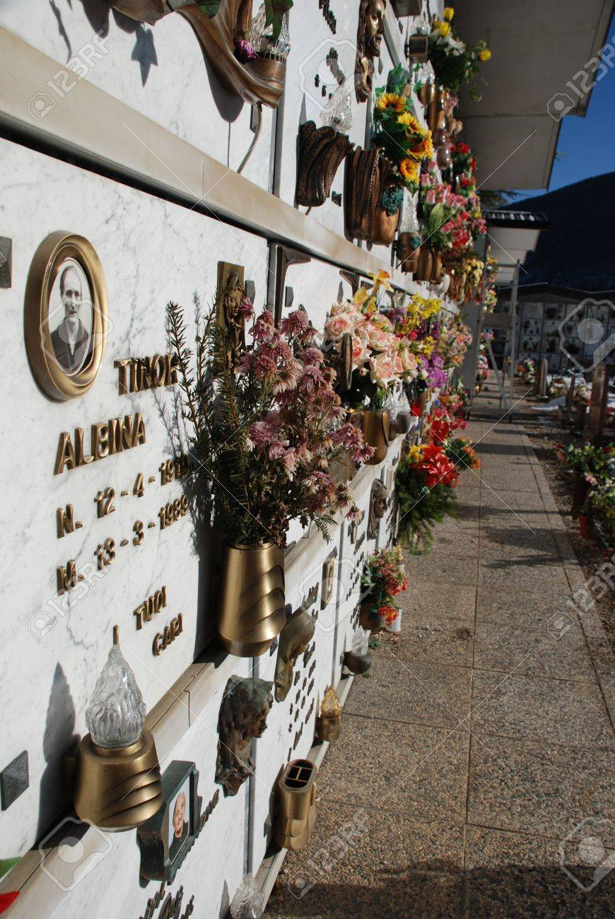 barcis italy 12 26 08 a burial wall in a snowy cemetery despite
