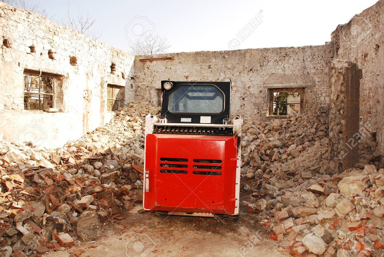 A skid steer loader in a partially demolished derelict old Italian farm building Stock Photo - 7826598