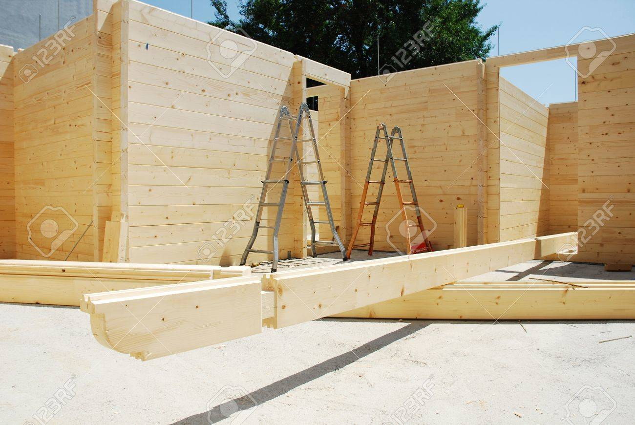 Ladders in a partially constructed wood (fir) block house, a