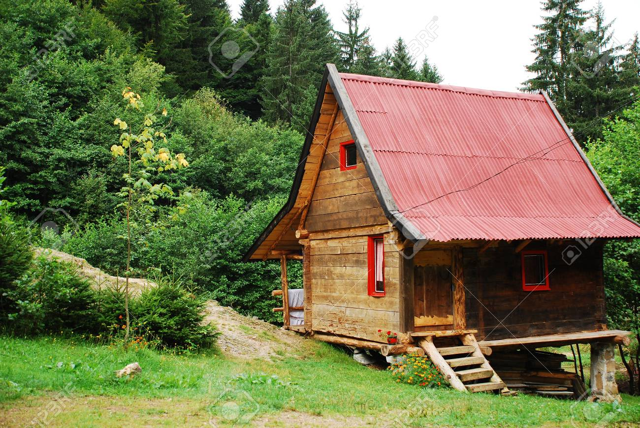 A Wooden Hut Located Deep In The Bosnian Forest Next To A Small Lake Stock  Photo