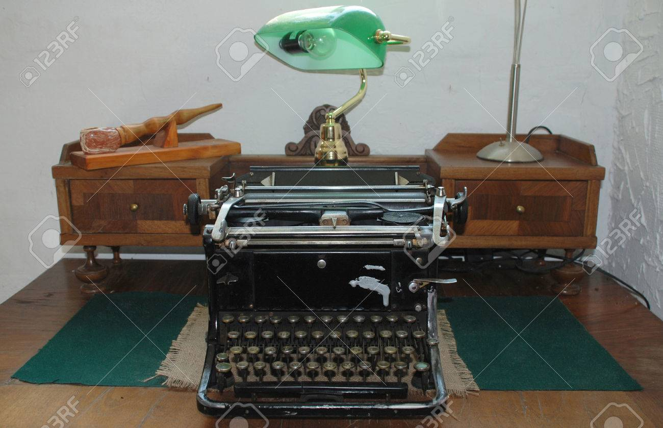 An antique manual typewriter on a antique wooden desk. Stock Photo -  47714286 - An Antique Manual Typewriter On A Antique Wooden Desk. Stock Photo