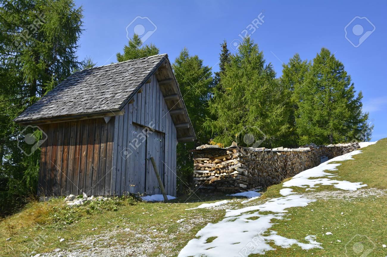 A Small Wooden Hut In The Snow On The Slopes Of Monte Lussari, Friuli  Venezia