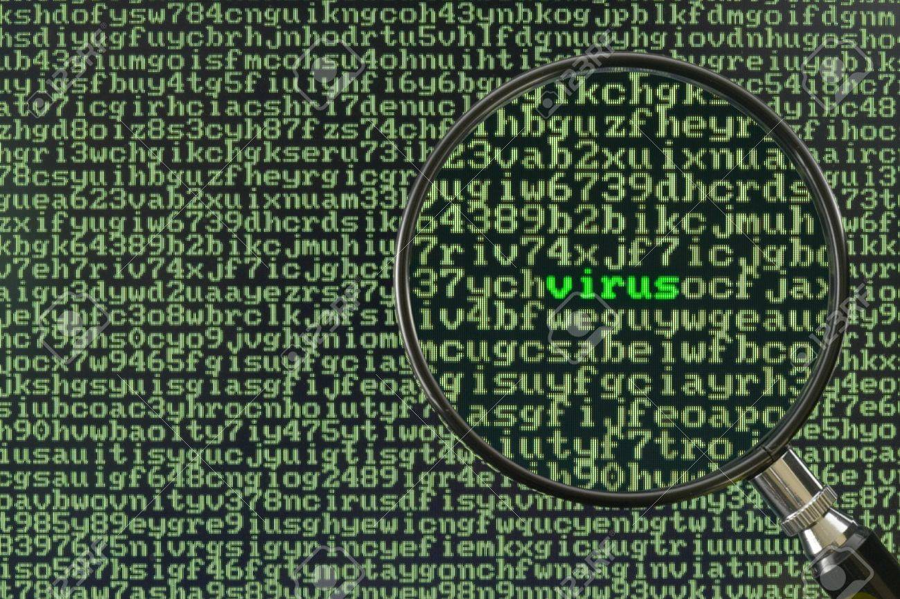 Magnifying glass focusing on the word Virus on a screen full of alphanumerics Stock Photo - 2252520