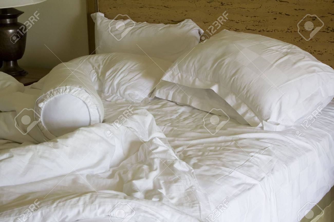 Rumpled bed sheet - Crumpled Bed Messy Unmade Bed With Pillow And Quilt Cover Stock Photo