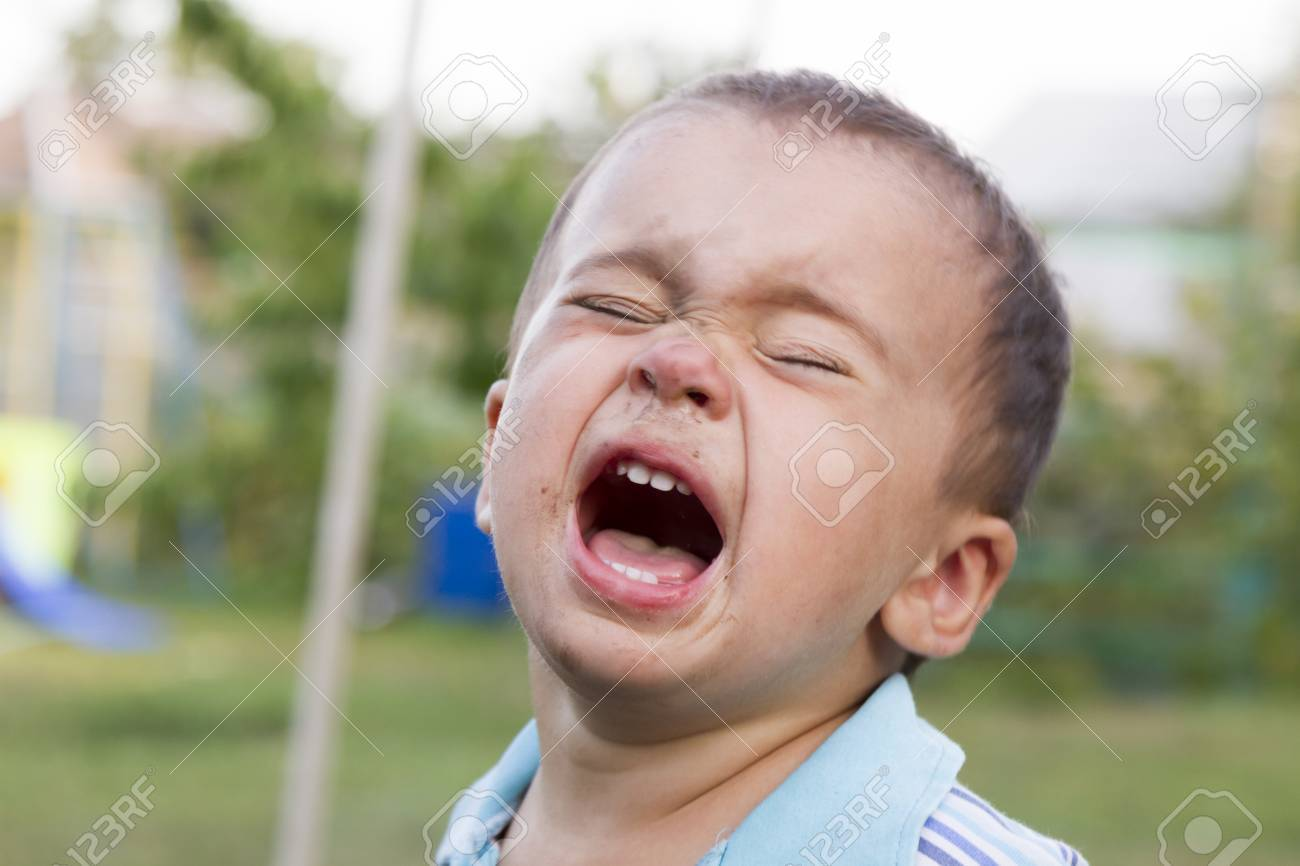 angry sad and unhappy baby child shouting and crying problem
