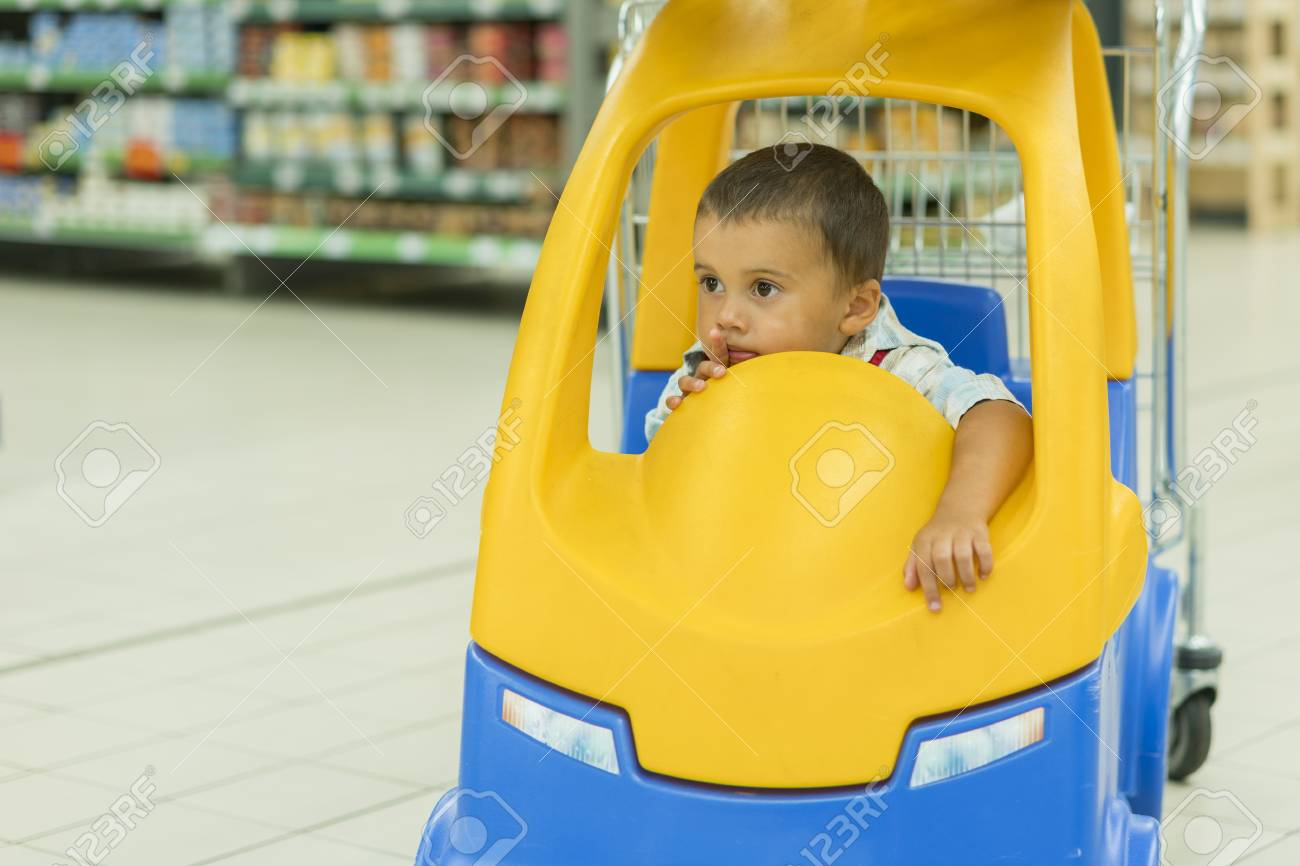 Cute Little 2 Year Old Baby Boy Child In The Toy Car Trolley