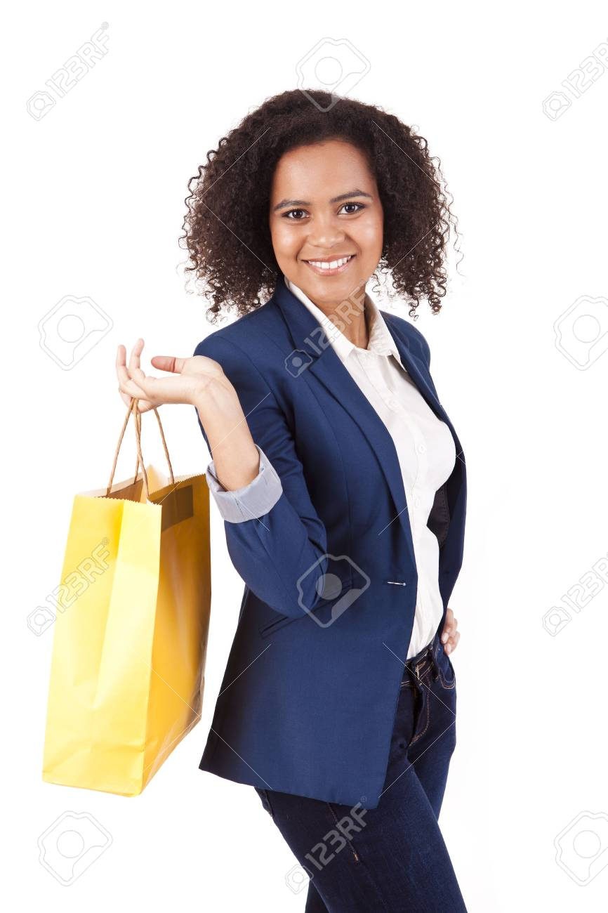 Beautiful african woman holding shopping bags Stock Photo - 17242536