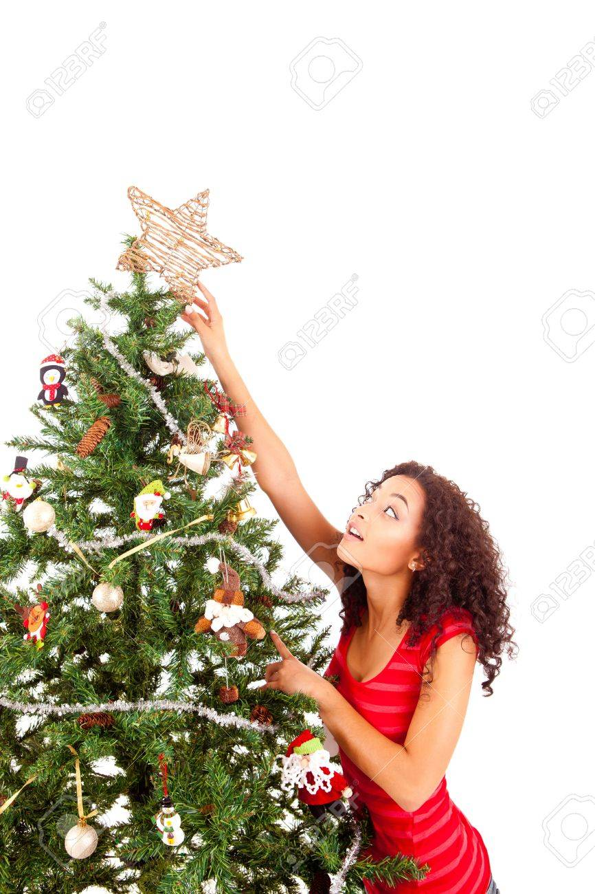 beautiful african woman decorating christmas tree stock photo 17300424