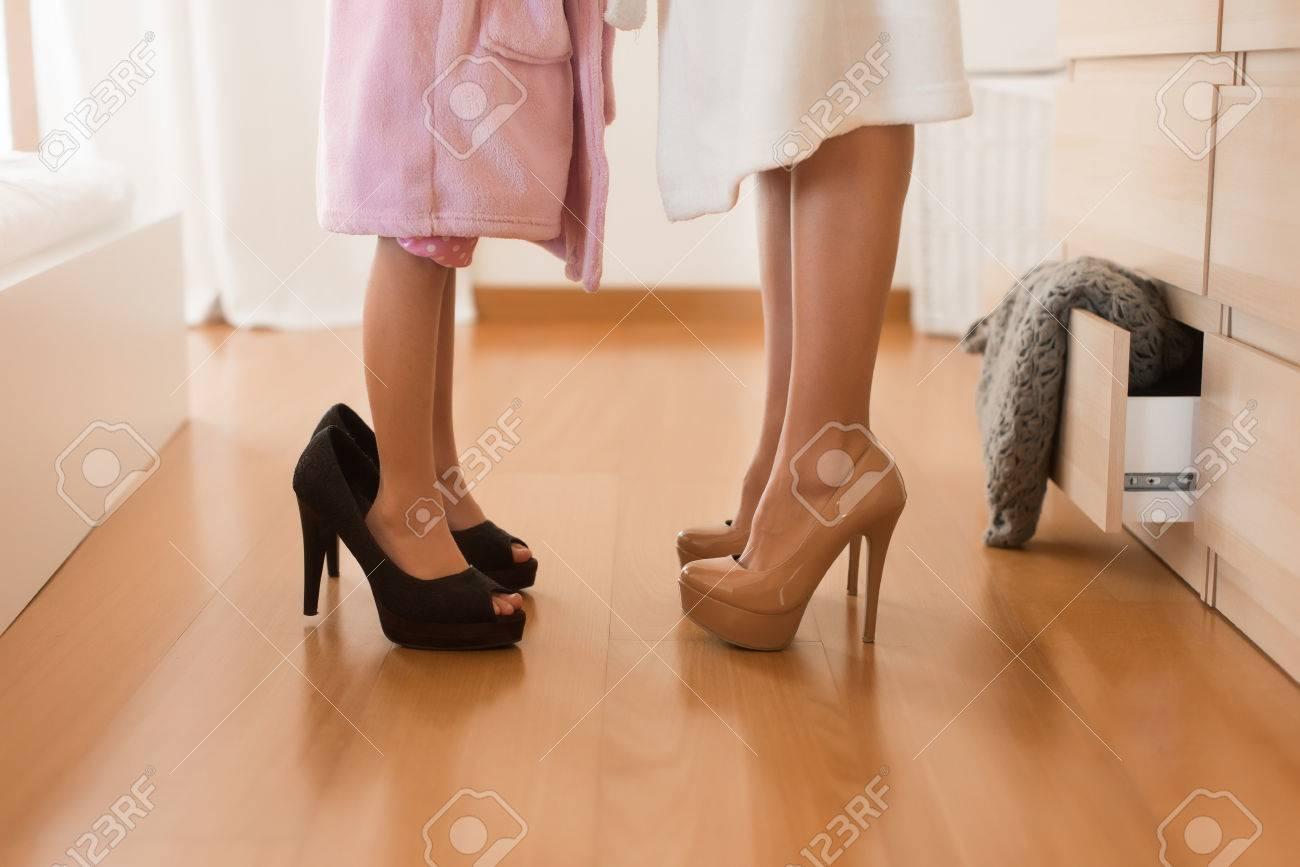 Little Girl Wearing Heels With Her Mother In Bedroom Stock Photo   51400724