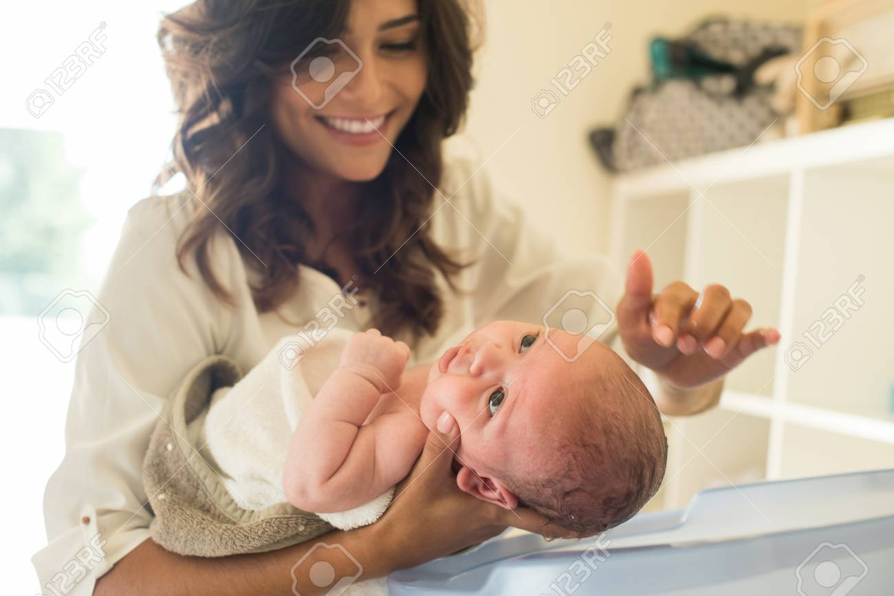 Mother Washing A Newborn Baby In A Bath Tub Stock Photo, Picture And ...