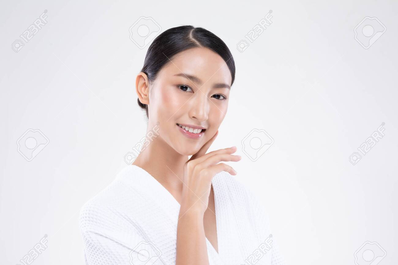 Beautiful Asian woman touching soft cheek smile with clean and fresh skin Happiness and cheerful with positive emotional,isolated on white background,Beauty and Cosmetics Concept - 137860448