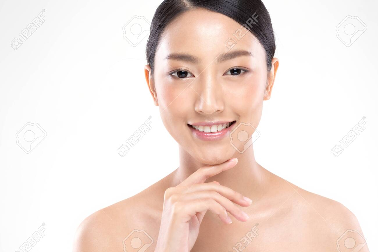Beautiful Young Asian Woman Looking While Touching Chin feeling so happy and cheerful with healthy Clean and Fresh skin,isolated on white background,Beauty Cosmetology Concept - 137860450