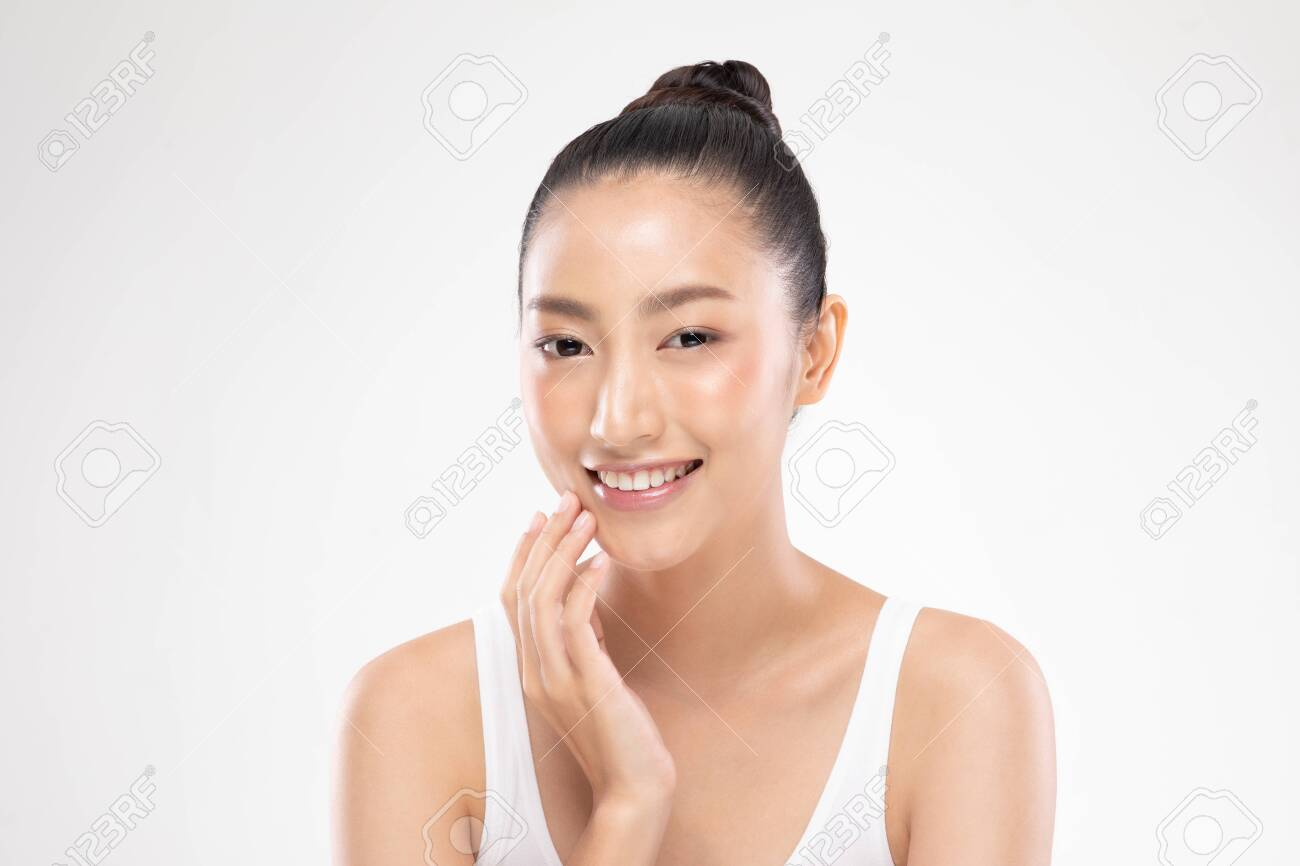 Beautiful Asian young woman touching soft cheek smile with clean and fresh skin Happiness and cheerful with positive emotional,isolated on white background,Beauty and Cosmetics Concept - 138152036