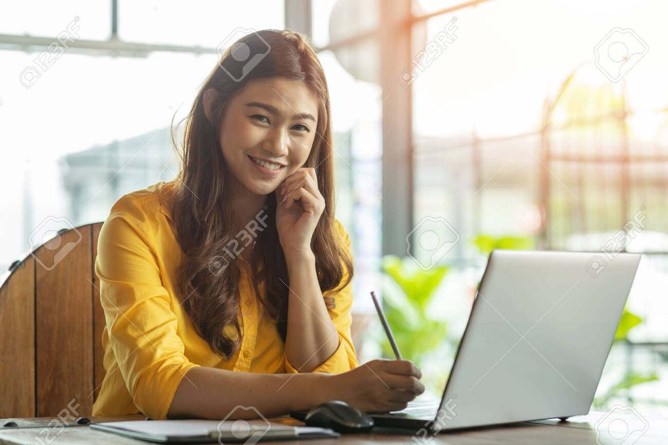 Beautiful Attractive Asian woman working with computer laptop and thinking to get ideas and requirement in Business startup feeling so happiness,Business Startup Concept - 139514022