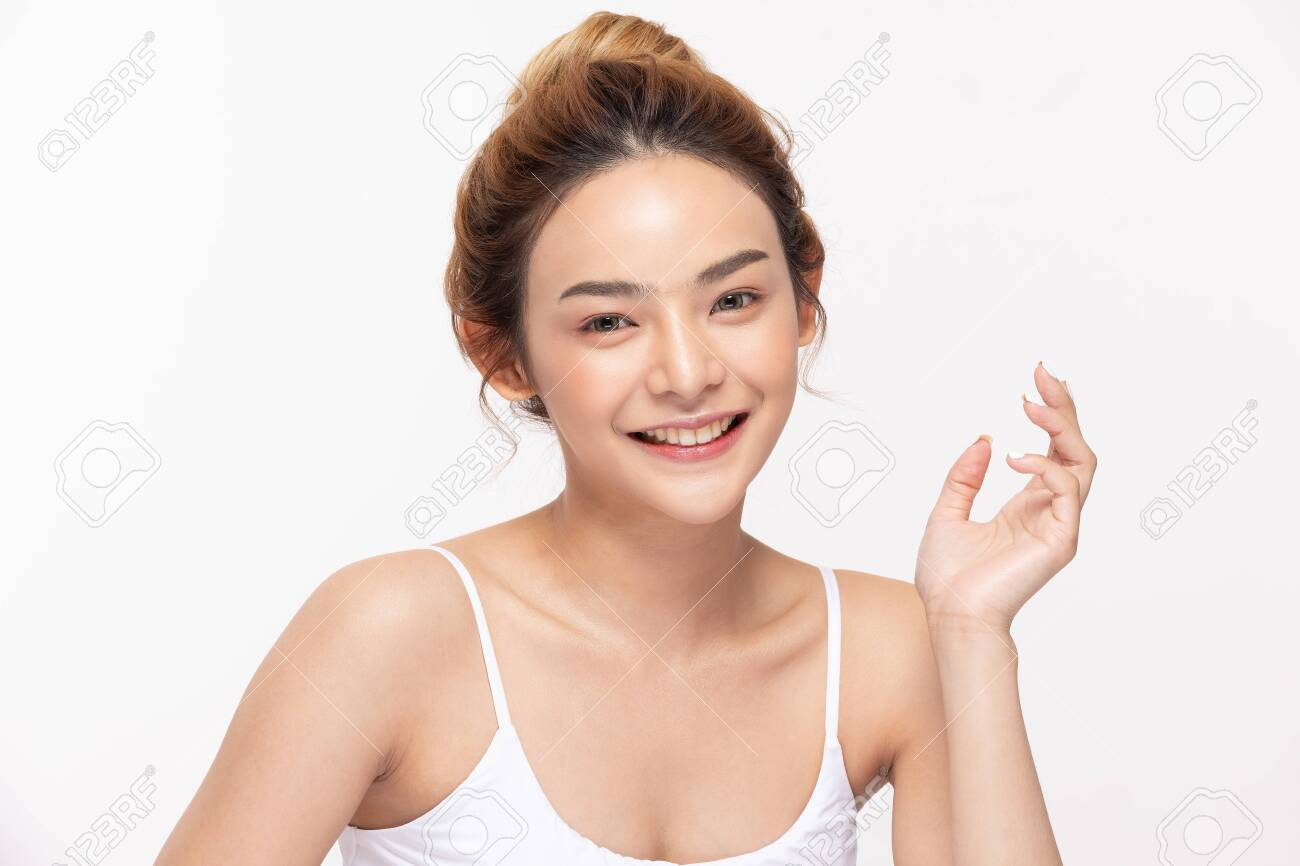 Beautiful Asian woman looking at camera smile with clean and fresh skin Happiness and cheerful with positive emotional,isolated on white background,Beauty and Cosmetics Concept - 156590496