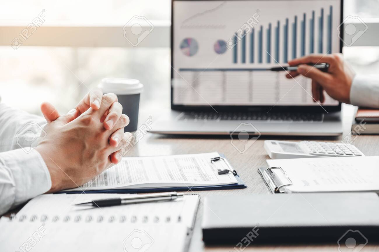 Business team meeting Strategy Planning with new startup project plan Finance and Economy Graph with laptop successful teamwork - 130738328