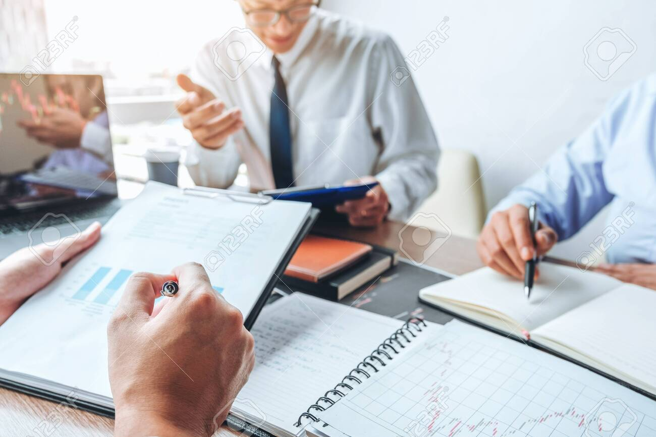 Business team meeting Strategy Planning with new startup project plan Finance and Economy Graph with laptop successful teamwork - 130738332