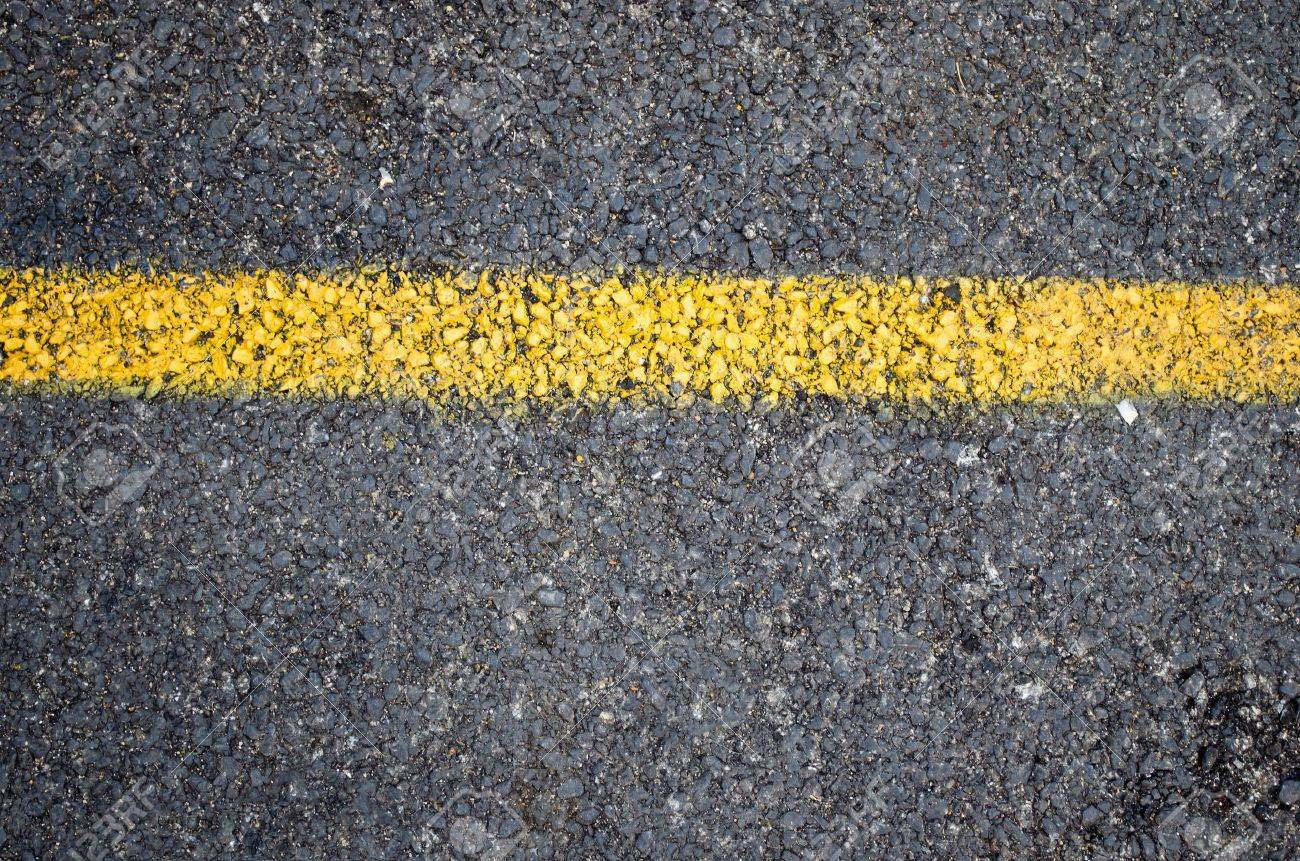 a yellow line on the road Stock Photo - 12886572