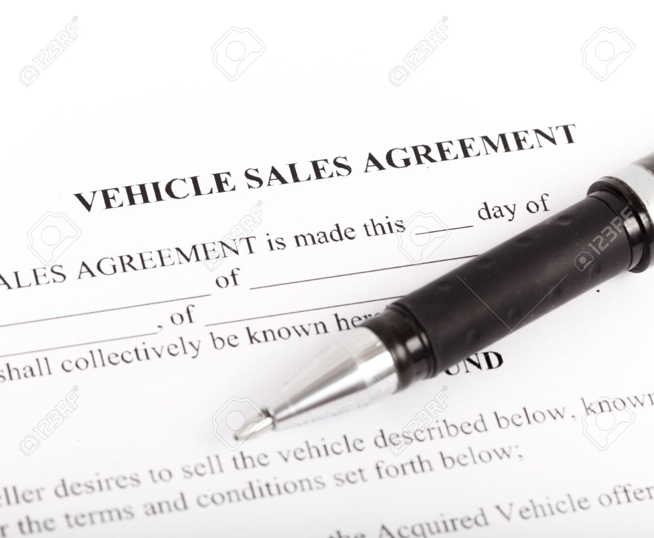 document and form of a vehicle sales agreement stock photo picture