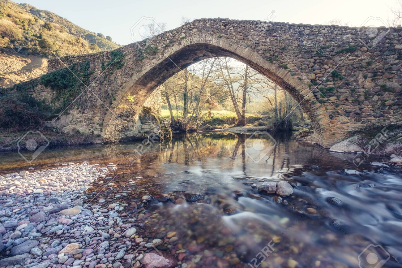 Ancient Genoese stone bridge over the fast flowing Tartagine river at Piana in the Balagne region of Corsica - 120885452