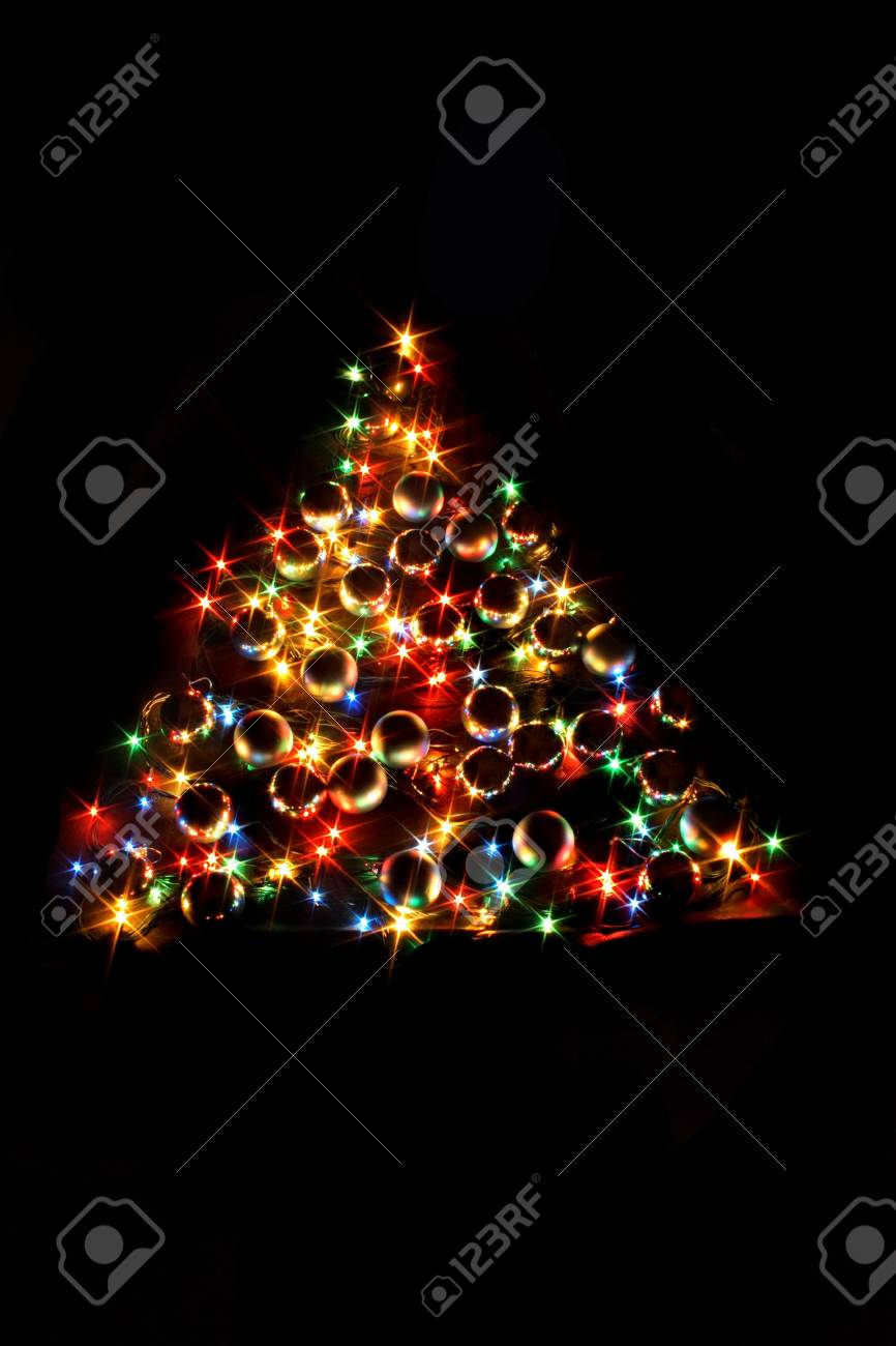 árbol de Navidad de color sobre el fondo negro Foto de archivo - 1830947