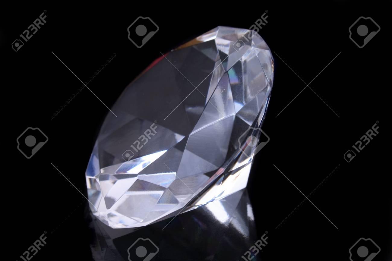 beautiful diamond on the black glass  background Stock Photo - 2492269