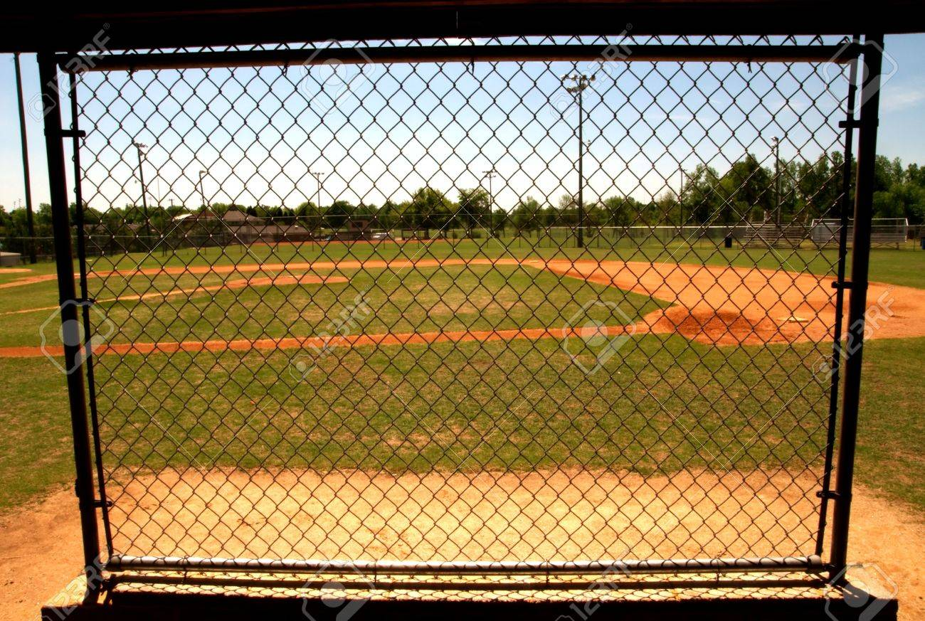 Chain Link Fence In The Dugout On A Baseball Field Stock Photo