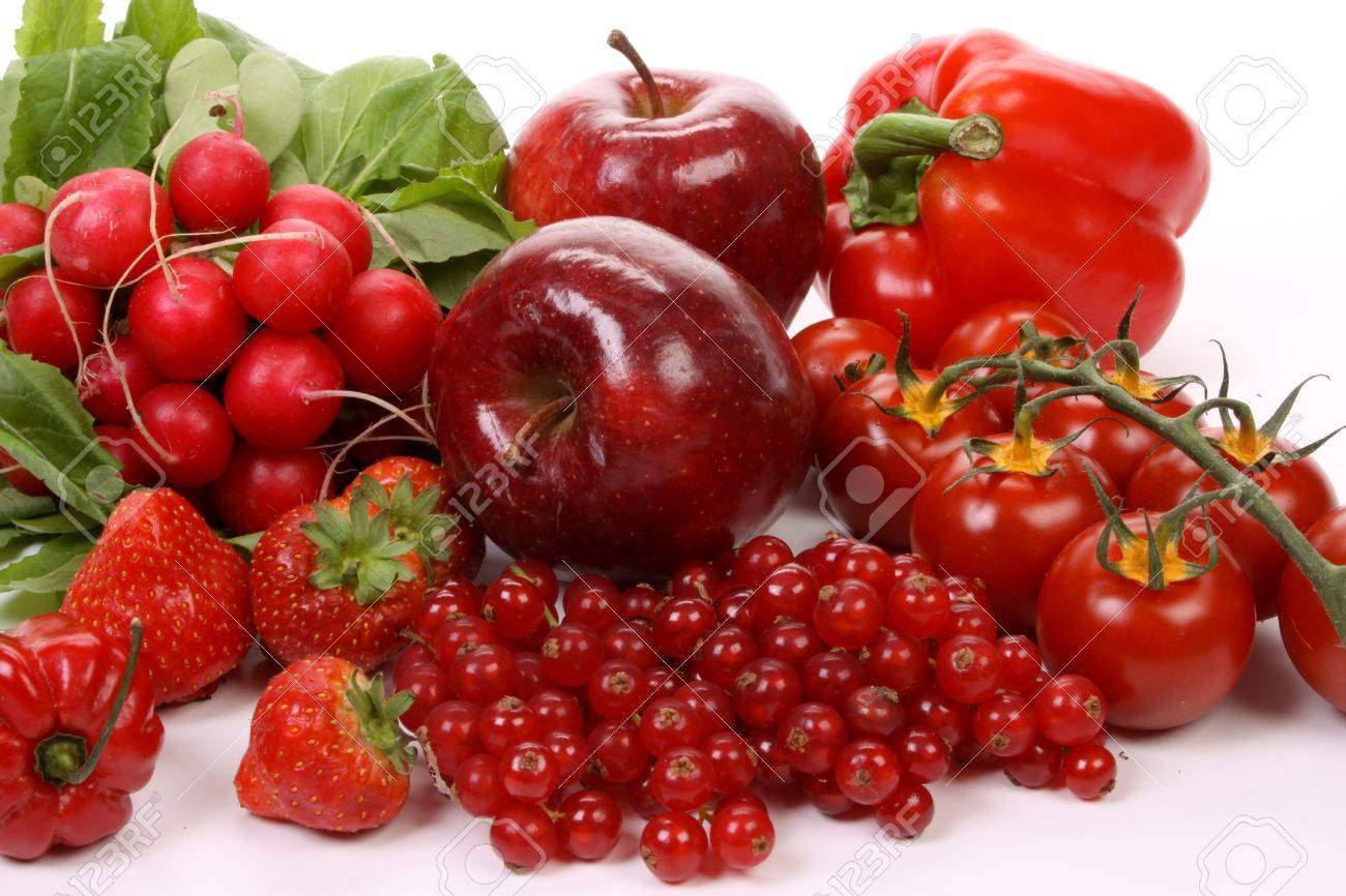 composition of several red fruits over white stock photo picture