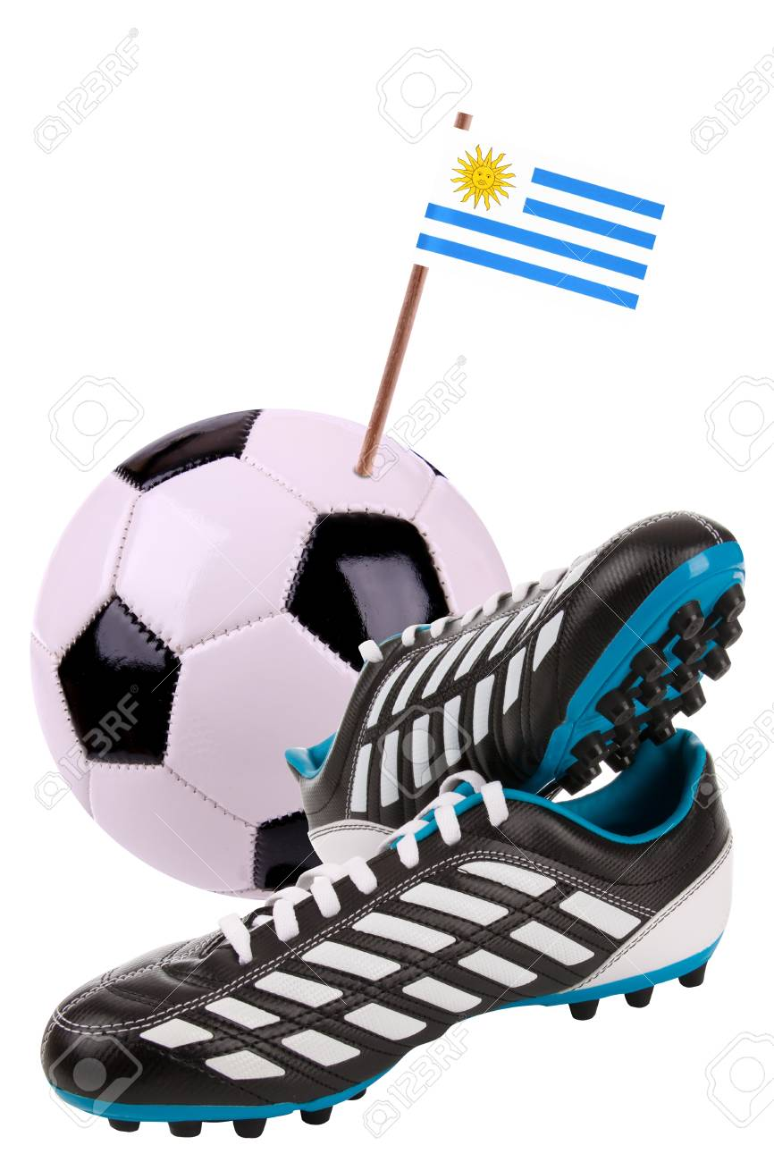 uk availability 5efc1 fb9ba Pair of cleats or football boots with a small flag of Uruguay Stock Photo -  13348561