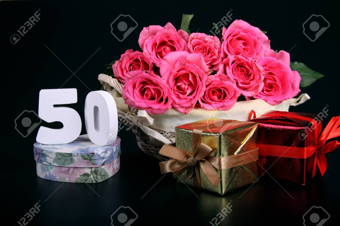 Number of age in a colorful studio setting with pink roses against a black background Stock Photo - 18291265