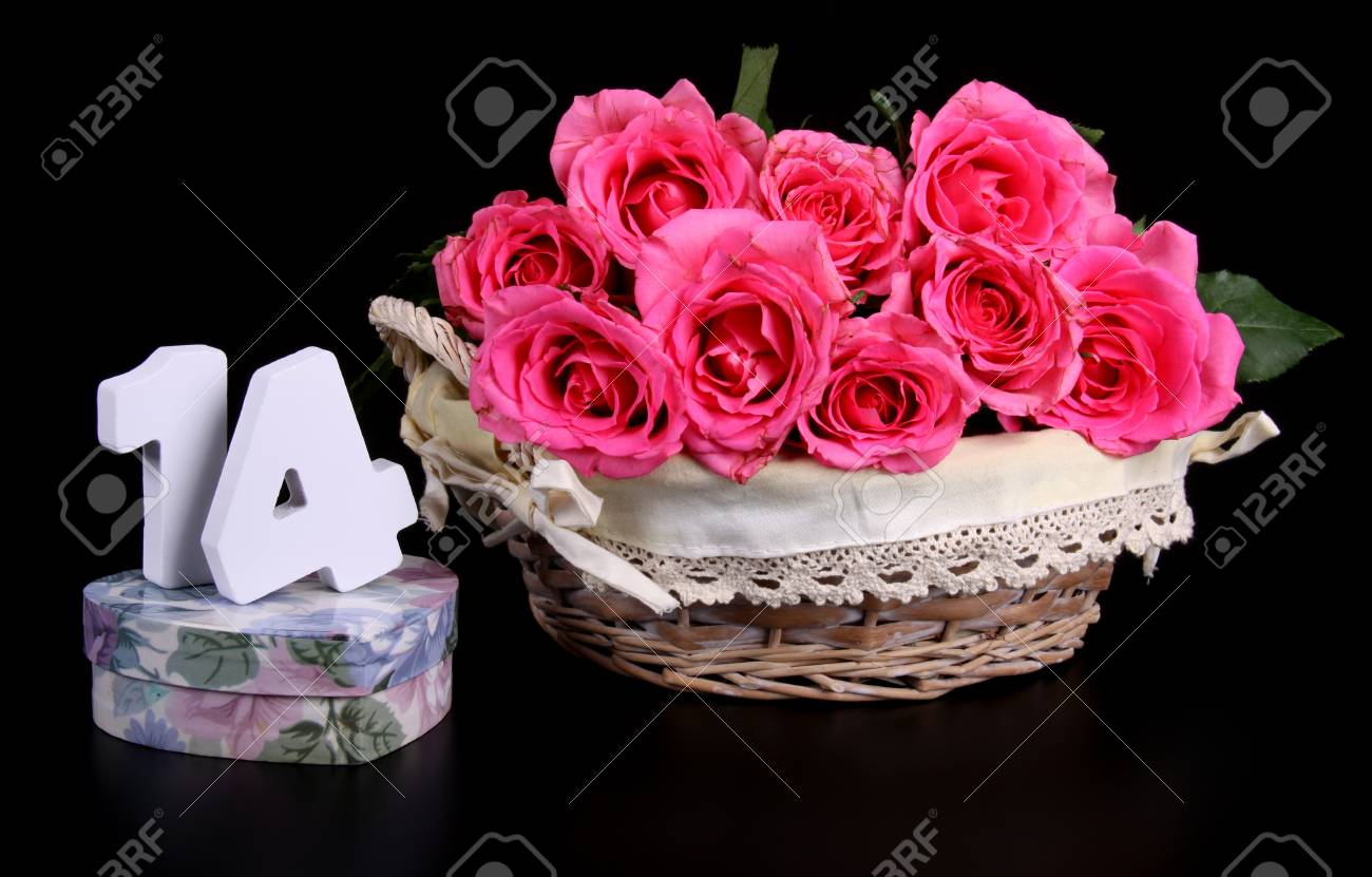 Number of age in a colorful studio setting with pink roses against a black background Stock Photo - 18744725