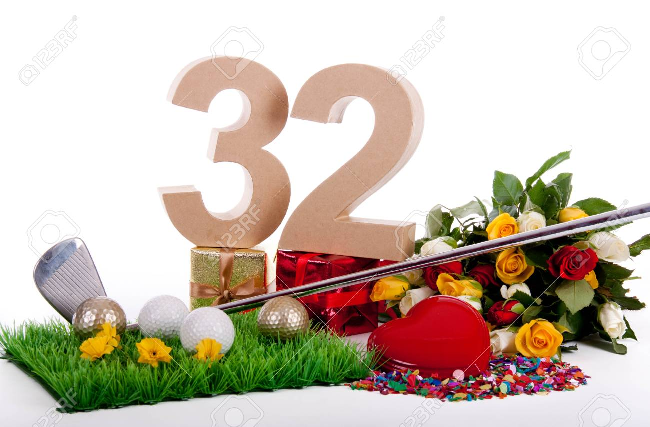 Roses, a golf club and golf balls on an artificial peace of grass to be used as a birthday card Stock Photo - 18744555