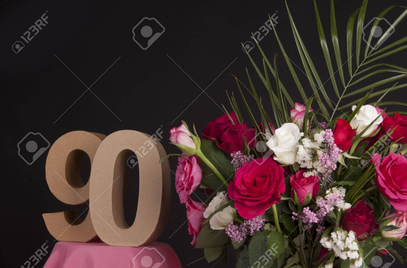 Age in figures next to a bouquet of flowers on a black background Stock Photo - 28649561