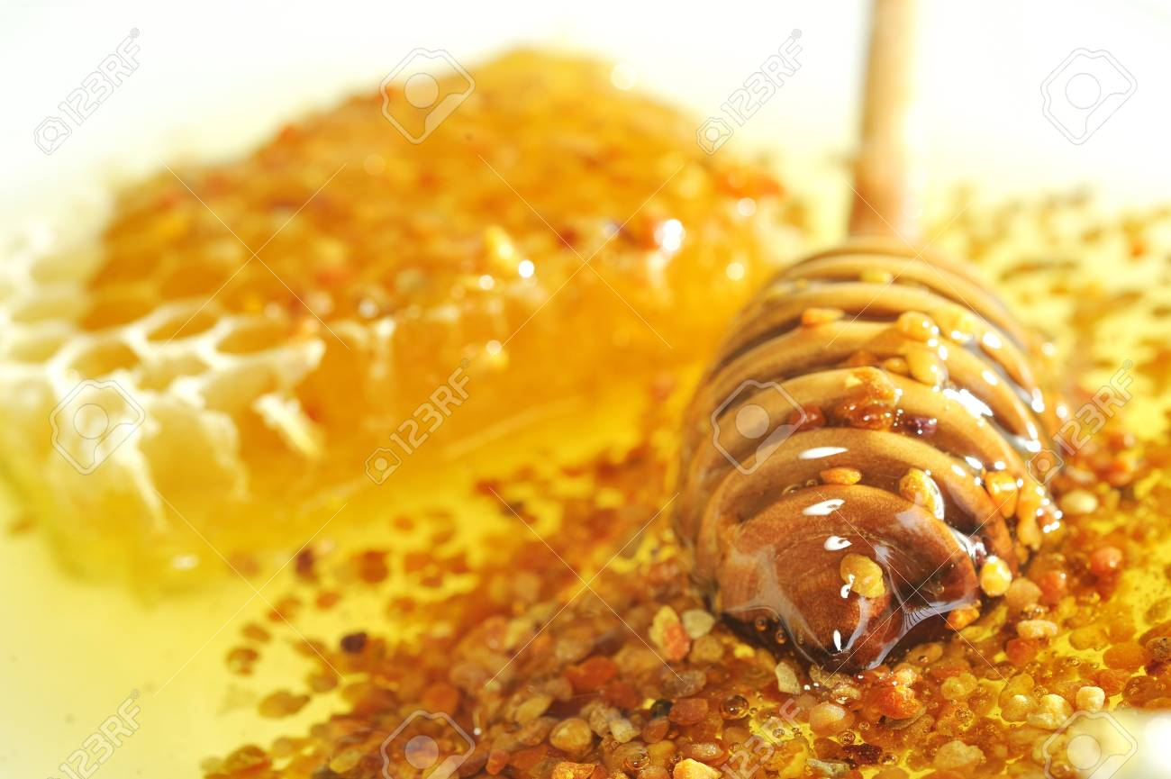 honey with wood stick Stock Photo - 8784064